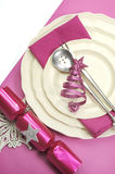Beautiful fuchsia pink festive Christmas dining table place setting - vertical Stock Photo