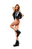 Beautiful full body blonde russian woman posing with black motor. Sexy young beautiful full body blonde russian woman posing with black motorcycle helmet Royalty Free Stock Photos