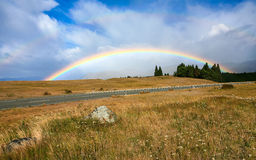 Beautiful full double rainbow over road Royalty Free Stock Image