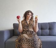 Beautiful full girl curly hair apple and cake, expression  choice  emotion sofa