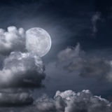 Beautiful full moon. Behind fantasy cloudy sky Royalty Free Stock Image
