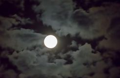 Beautiful full moon and white cloudy sky background in the midnight sky background, moonlight on Halloween night without stars. Full moon and white cloud sky in Stock Photography
