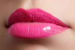 Beautiful full pink lips and white teeth. Pink lipstick. Gloss lips. Make-up & Cosmetics Stock Images