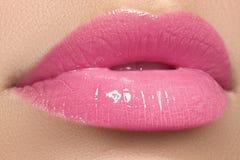 Beautiful full pink lips and white teeth. Pink lipstick. Gloss lips. Make-up Stock Images