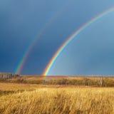 Beautiful Full Rainbow above Farm Field at Spring Stock Photos