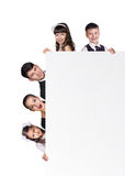 Beautiful fun family behind a white blank Royalty Free Stock Photos