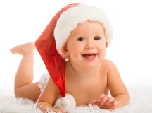 Beautiful funny baby in a Christmas hat isolated on white Royalty Free Stock Image