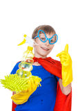 Beautiful funny child dressed as superhero cleaning. Beautiful cheerful child dressed as superman cleaning with a sponge and a sprayer showing thumbs up  ( Stock Image