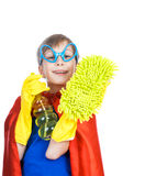 Beautiful funny child dressed as superman cleaning windows. Beautiful cheerful child dressed as superman cleaning with a sponge and a sprayer (cleaning concept Stock Photography