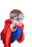 Beautiful funny child dressed as superman flying. Showing his fist (superhero concept Stock Images