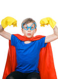 Beautiful funny child looking strong. Beautiful cheerful child dressed as superman flexing his muscles looking strong (strength concept Royalty Free Stock Image