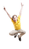 Beautiful funny child in yellow t-shirt jumping in excitement and laughing Royalty Free Stock Photography