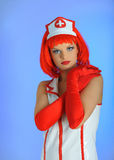 Beautiful funny  female doctor with red hair Royalty Free Stock Photos