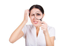 Beautiful funny girl searching with magnifier. Isolated Royalty Free Stock Images