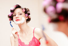 Beautiful funny girl shaving with foam & razor her face Royalty Free Stock Photos