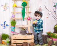 Beautiful funny little boy playing among easter spring scenery. stock image