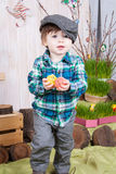 Beautiful funny little boy playing among easter spring scenery. royalty free stock image