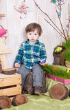 Beautiful funny little boy playing among easter spring scenery. royalty free stock photos