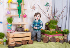 Beautiful funny little boy playing among easter spring scenery. royalty free stock images