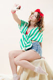 Beautiful funny pinup woman taking selfie photo Royalty Free Stock Photo