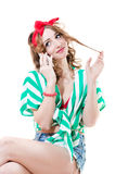Beautiful funny pinup young woman speaking on mobile Stock Photography