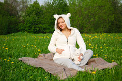 Beautiful funny pregnant woman in a suit lamb Stock Photos