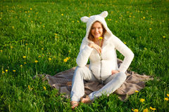 Beautiful funny pregnant woman in a suit lamb Royalty Free Stock Images