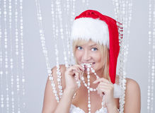 Beautiful funny woman with bead curtains Royalty Free Stock Images