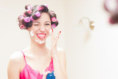 Beautiful funny girl applying shaving foam to her face Royalty Free Stock Photo