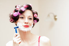 Beautiful funny girl shaving with foam & razor her face Royalty Free Stock Images