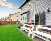 Beautiful furnished back yard with patio and fence. Stock Images