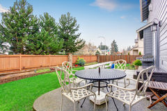 Beautiful furnished back yard with patio and fence. Royalty Free Stock Photos