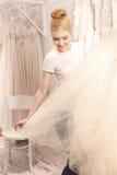 Beautiful future bride is choosing elegant clothing Stock Photo