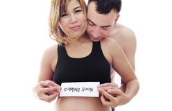 Beautiful future parents: his pregnant asian wife and a happy husband welcome baby coming soon Royalty Free Stock Images