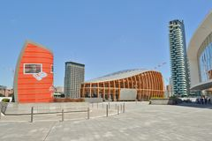 Beautiful futuristic architecture of Gae Aulenti square in Milan downtown. royalty free stock photos