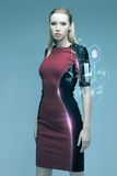Beautiful futuristic woman with virtual projection Stock Image