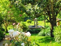 Beautiful Garden. Asturias. Spain. Spectacular garden with lots of color and a well. Asturias. Spain Royalty Free Stock Photography