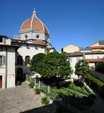 A beautiful Garden in the centre of Florence with the Dome of Cathedral Santa Maria del Fiore. A beautiful Garden in the centre of Florence with the Dome of Stock Photo