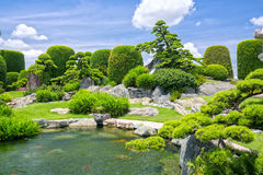 Beautiful garden in the ecotourism is designed in harmony. With many cypress, pine, stone, water and ancient trees bearing the traditional culture of Royalty Free Stock Photos