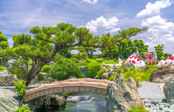 Beautiful garden in the ecotourism is designed in harmony. With many cypress, pine, stone, water and ancient trees bearing the traditional culture of Stock Photography