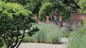 Beautiful garden with a fountain. Fountain at a formal garden Loop ready File stock video footage