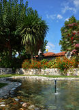 Beautiful garden with fountain Stock Photography