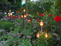 Beautiful garden with lamps Royalty Free Stock Photo