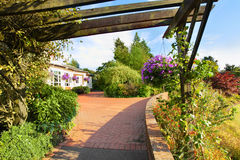 Beautiful garden in the park. With wooden pergola Stock Image
