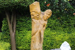 Beautiful garden and sculpture in a hotel compound. Beautiful garden and wooden sculpture in an Ethiopian hotel compound Stock Images
