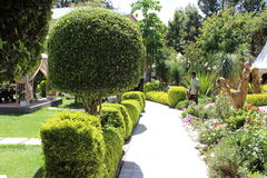 A beautiful garden and sculpture in a hotel compound. A beautiful garden and wooden sculpture in an Ethiopian hotel compound Stock Photo