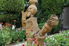 A beautiful garden and sculpture in a hotel compound. A beautiful garden and wooden sculpture in an Ethiopian hotel compound Stock Image