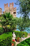Historic Gardens in Sirmione, Italy. Beautiful garden in Sirmione, a small town on the shores of Lake Garda (Lago di Garda) in Lombardy, Italy Stock Image