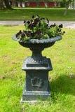 Beautiful garden stone flower planter stock image