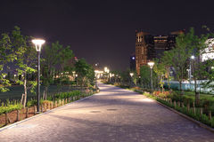 Beautiful garden walkway with lamps at night Royalty Free Stock Photography